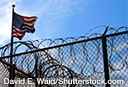 image of prison enclosure with US Flag